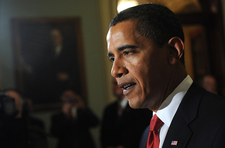 President Barack Obama addresses the media in between meetings with House and Senate republicans, January 27, 2009.