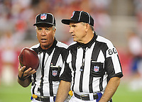 Aug. 22, 2009; Glendale, AZ, USA; NFL referees Kirk Dornan (left) with Greg Gautreaux during the game between the Arizona Cardinals against the San Diego Chargers during a preseason game at University of Phoenix Stadium. Mandatory Credit: Mark J. Rebilas-