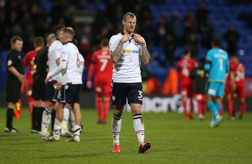 Bolton Wanderers' David Wheater shows his dejection at the final whistle after his team lost 2-1 after leading 1-0<br /> <br /> Photographer Stephen White/CameraSport<br /> <br /> The EFL Sky Bet League One - Bolton Wanderers v Swindon Town - Saturday 14th January 2017 - Macron Stadium - Bolton<br /> <br /> World Copyright &copy; 2017 CameraSport. All rights reserved. 43 Linden Ave. Countesthorpe. Leicester. England. LE8 5PG - Tel: +44 (0) 116 277 4147 - admin@camerasport.com - www.camerasport.com
