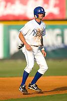 Burlington second baseman Kyle Martin (21) takes his lead off of second base versus Johnson City at Burlington Athletic Park in Burlington, NC, Saturday, August 25, 2007.