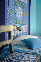 Pattern and multiple shades of blue overwhelm the senses in this bedroom
