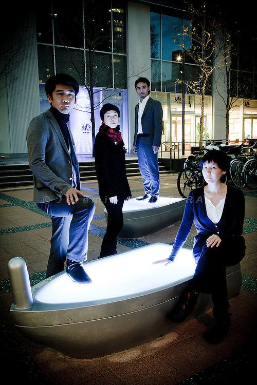Tokyo, December 14 2010 - Portraits of the collective of Japanese designers Plaplax in front of the Toyosu building, posing with one of their interactive sculpture.