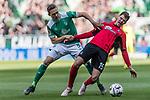 13.04.2019, Weserstadion, Bremen, GER, 1.FBL, Werder Bremen vs SC Freiburg<br /> <br /> DFL REGULATIONS PROHIBIT ANY USE OF PHOTOGRAPHS AS IMAGE SEQUENCES AND/OR QUASI-VIDEO.<br /> <br /> im Bild / picture shows<br /> Ludwig Augustinsson (Werder Bremen #05) im Duell / im Zweikampf mit Pascal Stenzel (SC Freiburg #15), <br /> <br /> Foto © nordphoto / Ewert