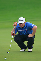 George Coetzee (RSA) on the 1st green during Thursday's Round 1 of the 2014 BMW Masters held at Lake Malaren, Shanghai, China 30th October 2014.<br /> Picture: Eoin Clarke www.golffile.ie