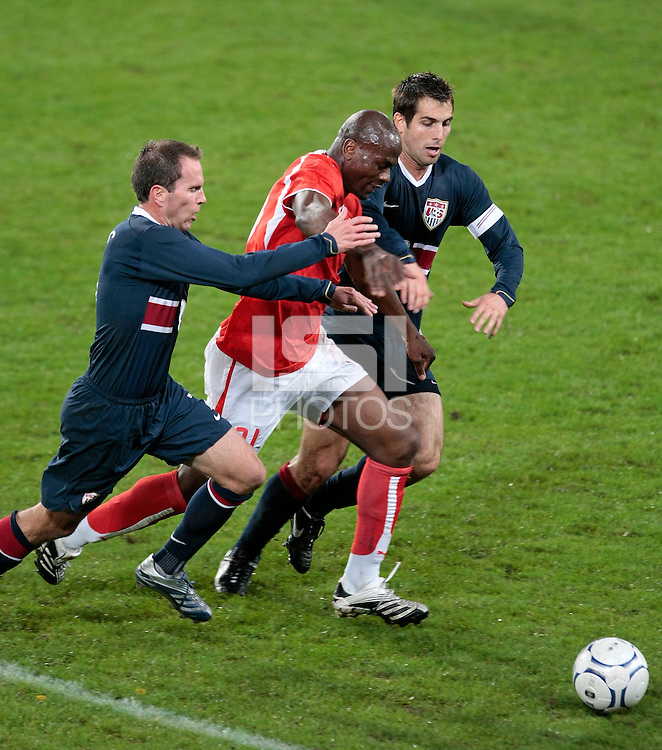 Switzerland forward (31) Blaise Nkufo is double teamed by USA midfielder (7) Eddie Lewis and defender (3) Carlos Bocanegra. The United States Men's National Team (USA) defeated Switzerland (SUI) 1-0 during an international friendly at St. Jakob Park, Basel, Switzerland, on October 17, 2007.