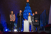 United States President Barack Obama (C-L) prepares to light the National Christmas tree with his daughters Malia (L) and Sasha (C), his mother-in-law Marian Robinson (C-R) and wife Michelle Obama (R) during the 91st National Christmas Tree Lighting Ceremony on the Ellipse south of the White House in Washington, DC, USA, 06 December 2013. The lighting of the tree is an annual tradition attended by the US President and the First Family. President Calvin Coolidge lit the first National Christmas tree, a 48-foot Balsam fir, in 1923.<br /> Credit: Jim LoScalzo / Pool via CNP