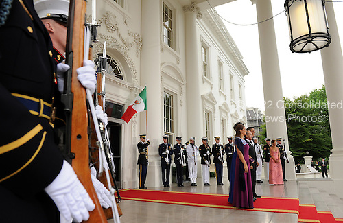 The United States Military Honor Guard stands by as U.S. President Barack Obama and First Lady Michelle Obama welcome Mexican President Felipe Calderon and Mexican First Lady Margarita Zavala on the North Portico of the White House for a State Dinner in Washington on Wednesday, May 19, 2010.   .Credit: Roger L. Wollenberg - Pool via CNP