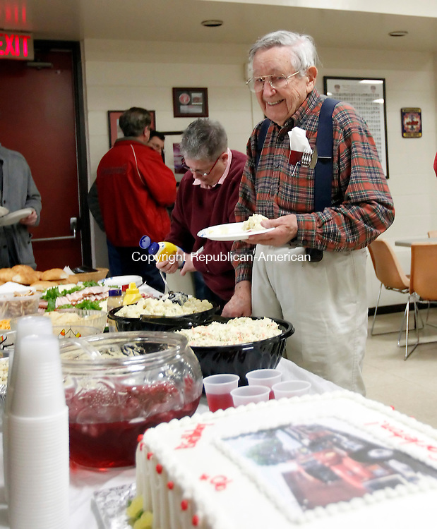 Woodbury, CT-31 December 2011-123111CM10-  Carleton Quint, former Woodbury Volunteer Fire Department Chief and Postmaster of Woodbury has a laugh about his birthday cake, during his surprise 90th birthday party Saturday afternoon at the Woodbury Emergency Services building. To the left is his daughter Pam Quint, of Andover, and one of the organizers the event.  After retiring from the Navy in 1945, Quint  moved back to Woodbury where he later became the Postmaster. Quint served with the Woodbury Volunteer Department for 33 years, including being Fire Chief from 1972-74.  Quint was met with family and friends who helped him celebrate his special day.  Christopher Massa Republican-American