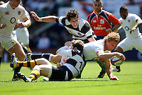 Billy Twelvetrees of England dives over from short range to score a try during the match between England and Barbarians at Twickenham on Sunday 26th May 2013 (Photo by Rob Munro)