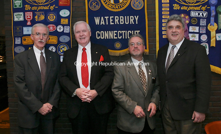 WATERBURY, CT 28 October 2005 -102805BZ10- <br /> From left- Leo Flanagan, of Waterbury, president; Bill Wright, of Waterbury, vice president; Fred Frank, of Stratford, Lt. Governor of Kiwanis district 24; and Ray Komorowski, of Oakville, immediate past president;<br /> <br /> during the installation of officers of the Kiwanis Club of Waterbury Friday night.<br /> Jamison C. Bazinet Republican-American