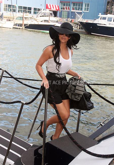 WWW.ACEPIXS.COM . . . . .  ....July 1 2010, New York City....Kim Kardashian boards a yacht at Chelsea Piers on July 1 2010 in New York City....Please byline: RIVERA/VAUGHAN- ACEPIXS.COM.... *** ***..Ace Pictures, Inc:  ..Tel: 646 769 0430..e-mail: info@acepixs.com..web: http://www.acepixs.com