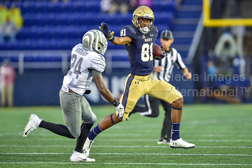 Annapolis, MD - September 8, 2018: Navy Midshipmen wide receiver Collins Woods III (81) runs the football for a first down pursued by Memphis Tigers defensive back Tito Windham (24) during game between Memphis and Navy at  Navy-Marine Corps Memorial Stadium in Annapolis, MD. (Photo by Phillip Peters/Media Images International)