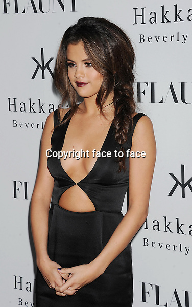Actress/singer Selena Gomez attends the Flaunt Magazine Issue Party with Selena Gomez And Amanda De Cadenet held at Hakkasan Beverly Hills on November 7, 2013 in Beverly Hills, California.<br />