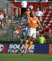 Houston Dynamo forward Brian Ching (25) and FC Dallas defender Clarence Goodson (11) go for the header.  Houston Dynamo defeated FC Dallas 1-0 in an MLS regular season match at Robertson Stadium in Houston, TX on August 19, 2007.