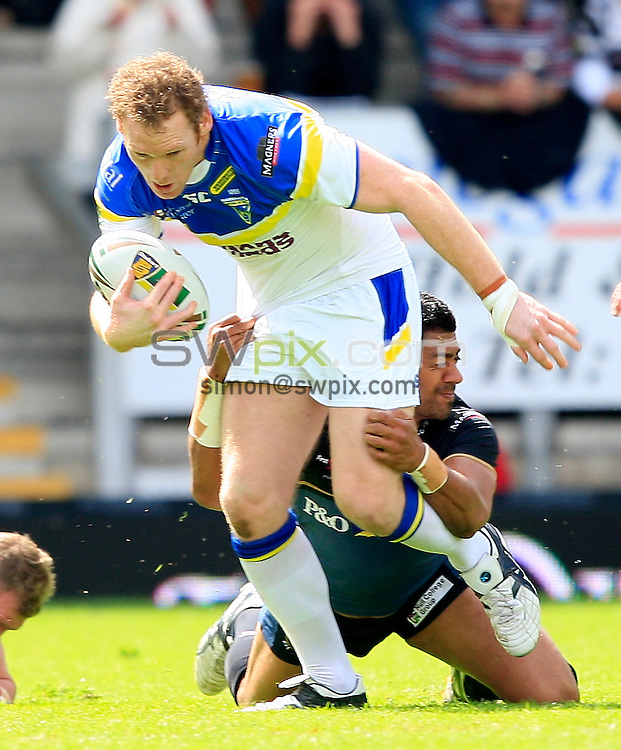 PICTURE BY CHRIS MANGNALL /SWPIX.COM...Rugby League - Super League  - Warrington Wolves v Hull FC - Halliwell Jones Stadium, Warrington, England  - 24/06/12... Warrington's Joel Monaghan  tackled by Hull's Willie Manu