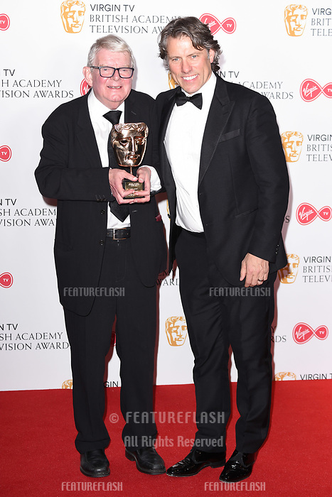John Motson and John Bishop in the winners room for the BAFTA TV Awards 2018 at the Royal Festival Hall, London, UK. <br /> 13 May  2018<br /> Picture: Steve Vas/Featureflash/SilverHub 0208 004 5359 sales@silverhubmedia.com
