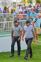 Anirban Lahiri (IND) and Charl Schwartzel (RSA) approach the first tee during round 2 Four-Ball of the 2017 President's Cup, Liberty National Golf Club, Jersey City, New Jersey, USA. 9/29/2017.<br /> Picture: Golffile | Ken Murray<br /> <br /> All photo usage must carry mandatory copyright credit (&copy; Golffile | Ken Murray)