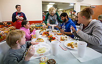 NWA Democrat-Gazette/BEN GOFF @NWABENGOFF<br /> Chris Schaefer, a volunteer from Bella Vista, serves the family of Felix Soto, Hollie Rea, Dylan Rea, 6, and Maddison Rea, 9, Thursday, Nov. 28, 2019, during the community Thanksgiving meal at the Salvation Army Emergency Shelter in Bentonville. The shelter served residents and community members in need from 11 a.m. to 2 p.m.