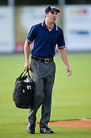 Umpire Jacob Danielsen delivers the bag full of game balls prior to the start of the South Atlantic League game between the Augusta GreenJackets and the Kannapolis Intimidators at Fieldcrest Cannon Stadium July 24, 2009 in Kannapolis, North Carolina. (Photo by Brian Westerholt / Four Seam Images)