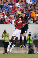 Danny Welbeck (19) of Manchester United goes up for a header against Danny Califf (4) of Philadelphia Union during a friendly match at Lincoln Financial Field in Philadelphia, Pennsylvania.  Manchester United defeated Philadelphia Union, 1-0.