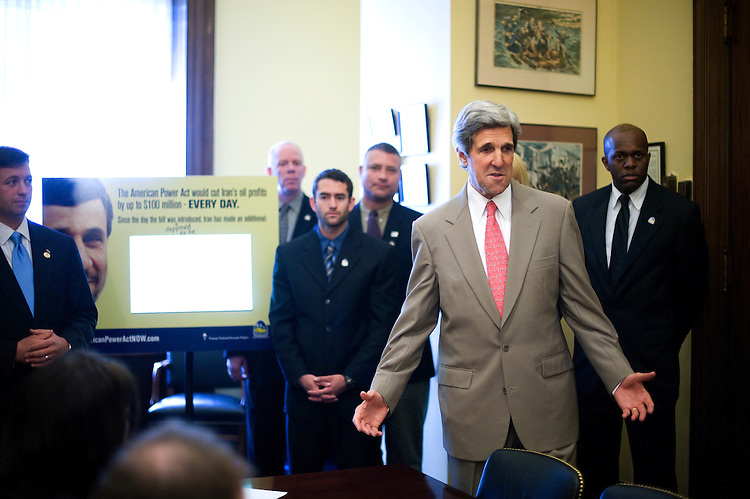 "Senate Foreign Relations Chairman John Kerry, D-Mass., talks to the media during the Operation Free event where they delivered a large digital counter that ""tallies Iranian oil revenues which the passage of the American Power Act could prevent"". The event was held in Kerry's office in the Russell Senate Office Building, on April 27, 2010...."
