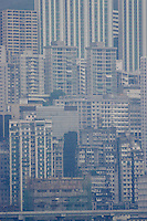 High rise flats at Hong Kong Island's North Point crowd in on each other and loom over the elevated highway which skirts the Harbour.