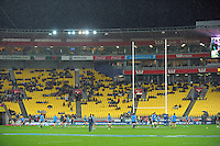 The rain falls as the teams warm up during the Super Rugby match between the Hurricanes and Chiefs at Westpac Stadium, Wellington, New Zealand on Friday, 17 May 2013. Photo: Dave Lintott / lintottphoto.co.nz