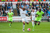 ( L-R )Andre Ayew of Swansea City  and Eliaquim Mangala of Manchester City in action during the Barclays Premier League match between Swansea City and Manchester City played at the Liberty Stadium, Swansea on the 15th of May  2016