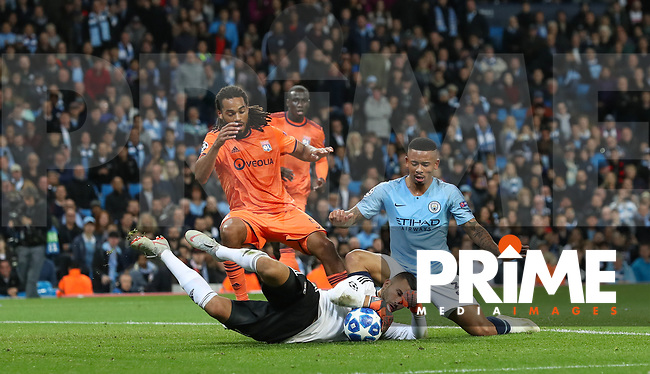 Goalkeeper Anthony LOPES of Olympique Lyonnais saves from Gabriel JESUS of Manchester City as Jason DENAYER of Olympique Lyonnais approaches during the UEFA Champions League match between Manchester City and Olympique Lyonnais at the Etihad Stadium, Manchester, England on 19 September 2018. Photo by David Horn / PRiME Media Images.