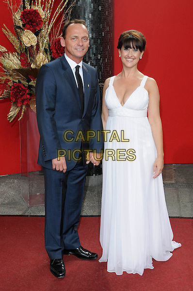 PERRY FENWICK & ANGELA LONSDALE.Arrivals - the British Soap Awards 2009, BBC Television Centre, Wood Lane, London, England..May 9th 2009.soaps tv full length Eastenders blue suit white long maxi dress navy black tie couple holding hands .CAP/FIN.©Steve Finn/Capital Pictures.