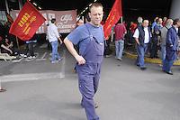 - meeting of workers in front of the Alfa Romeo factory in Arese (Milan) against the plant closing and dismissals....- assemblea dei lavoratori davanti allo stabilimento Alfa Romeo di Arese (Milano) contro la chiusura dell'impianto e i licenziamenti