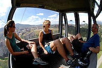 Two female and a male mountain bikers ride the gondola at the ski resort at Steamboat CO