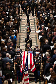 Former President George Bush and his wife former first lady Laura Bush, top center, follow the flag-draped casket of former President George H.W. Bush as it is carried out by a military honor guard during a State Funeral at the National Cathedral, Wednesday, Dec. 5, 2018, in Washington. <br /> Credit: Andrew Harnik / Pool via CNP