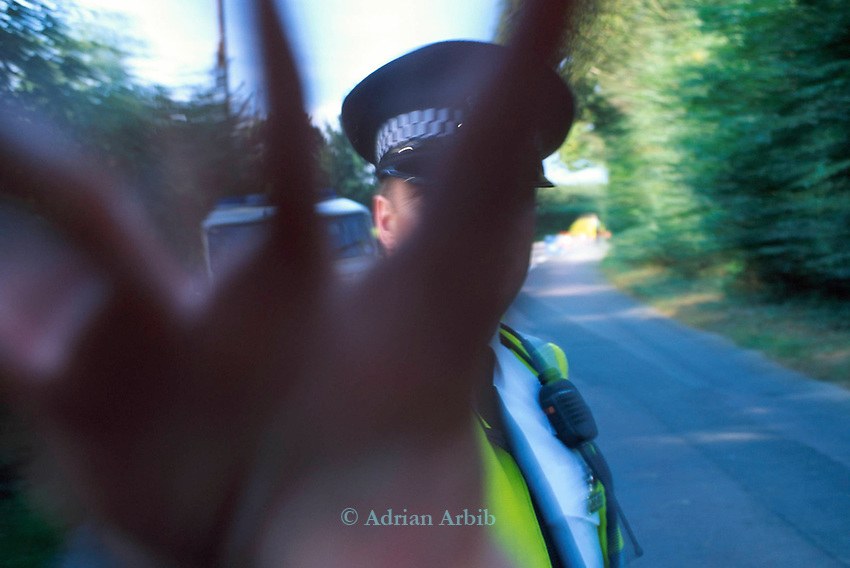 Arbib is  arrested  for taking a photograph of a police cordon as  police stop access to Horsmonden fair by around 100 Romanies