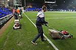 The groundsmen preparing to mow the pitch after the final whistle at Prenton Park as Tranmere Rovers lose to Stoke City in a Capital One Cup third round match. The Capital One cup was formerly known as the League Cup and was competed for by all 92 English Premier League and Football League clubs. Visitors Stoke City won the match 2-0, watched by a crowd of 5,559 spectators.