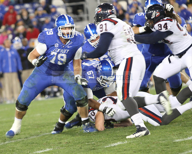 Junior offensive tackle Kevin Mitchell defends blocks Samford during the second half of the UK vs Samford at Commonwealth Stadium in Lexington, Ky., on Saturday, November 17th, 2012. Photo by Logan Douglas   Staff.