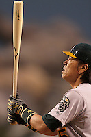 Oakland Athletics outfielder Hideki Matsui #55 bats against the Los Angeles Angels at Angel Stadium on September 24, 2011 in Anaheim,California. Los Angeles defeated Oakland 4-2.(Larry Goren/Four Seam Images)