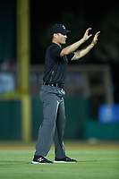 Umpire Mark Bass calls time during the Carolina League game between the Winston-Salem Dash and the Myrtle Beach Pelicans at TicketReturn.com Field on May 16, 2019 in Myrtle Beach, South Carolina. The Dash defeated the Pelicans 6-0. (Brian Westerholt/Four Seam Images)