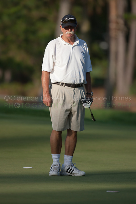 "PONTE VEDRA BEACH, FL - MAY 6: Jim Furyk's caddie Mike ""Fluff"" Cowan on the 12th green during the  practice round on Wednesday, May 6, 2009 for the Players Championship, beginning on Thursday, at TPC Sawgrass in Ponte Vedra Beach, Florida.  Fluff was the caddie for Tiger Woods from the time Tiger turned pro in 1996 through early 1999, when he was replaced by Steve Williams."