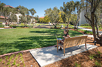 Jemma Parsons '16 uses Skype on her laptop as she sits on a bench in the newly remodeled entrance to Occidental College March 26, 2015.<br /> (Photo by Marc Campos, Occidental College Photographer)