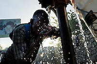 A Haitian man drinks safe water from a public water pump in Port-au-Prince, Haiti, 9 July 2008. Although Latin America (as a whole) is blessed with an abundance of fresh water, having 20% of global water resources in the the Amazon Basin and the highest annual rainfall of any region in the world, an estimated 50-70 million Latin Americans (one-tenth of the continent's population) lack access to safe water and 100 million people have no access to any safe sanitation. Complicated geographical conditions (mainly on the Pacific coast), unregulated industrialization (causing environmental pollution) and massive urban poverty, combined with deep social inequality, have caused a severe water supply shortage in many Latin American regions.