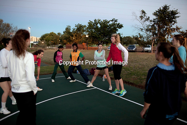 BLOEMFONTEIN, SOUTH AFRICA APRIL 18, 2013: Mix group of girls warm up before a netball practice at the University of the Free State sports grounds in Bloemfontein, South Africa. Photo by: Per-Anders Pettersson