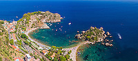 Panoramic photo of Isola Bella Island and Isola Bella Beach, Taormina, Sicily, Italy, Europe. This is a panoramic photo of Isola Bella Island in the Ionian Sea at Isola Bella Beach, Taormina, Sicily, Italy, Europe. This was taken from one of the panoramic view points in Taormina, which offer fantastic views over the Ionian Sea (part of the Mediterranean Sea).