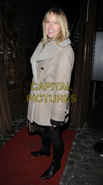 Carol McGiffin.Sid Owen's 40th birthday party, Gilgamesh bar & restaurant, The Stable Market, Chalk Farm Rd., London, England..January 12th, 2012.full length black tights beige jacket side sheepskin.CAP/CAN.©Can Nguyen/Capital Pictures.
