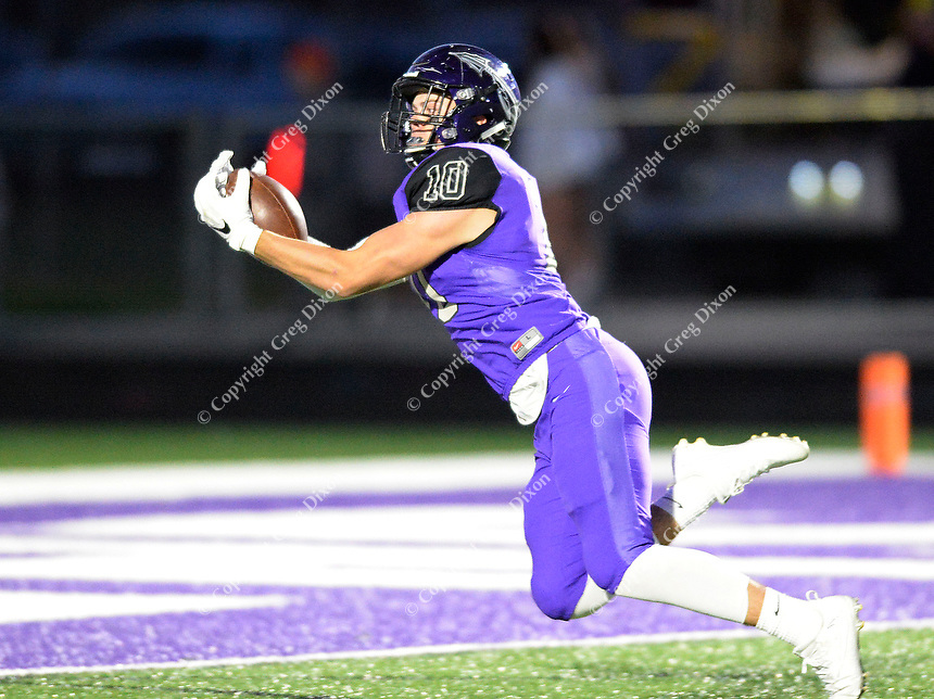 Waunakee's Austin Keller catches a pass and falls into the end zone for a touchdown in the first quarter, as Reedsburg takes on Waunakee in Wisconsin Badger North Conference high school football at Waunakee High School on Friday, 9/28/18