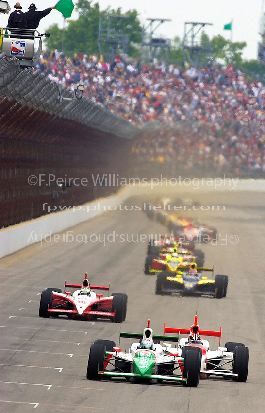 87th Indianapolis 500, Indianapolis Motor Speedway, Speedway, Indiana, USA  25 May,2003.Michael Andretti lead Helio Castroneves past the green flag..World Copyright©F.Peirce Williams 2003 .ref: Digital Image Only..F. Peirce Williams .photography.P.O.Box 455 Eaton, OH 45320.p: 317.358.7326  e: fpwp@mac.com..