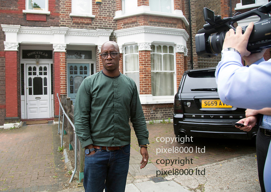 Pic shows: Ian Wright speaks to press outside his home in North London after jetting in from Rio de Janeiro<br /> <br /> Doorway of home in North West London  of  Ian Wright, former Arsenal and England star, ITV pundit,<br /> The house was apparently burgled and his wife Nancy threatened last night.<br /> <br /> Fingerprint dust is evidence around the doorway where apparently there was struggle as his wife tried to stop the intruders entering.<br /> <br /> 19.6.14<br /> <br /> <br /> <br /> <br /> Pic by Gavin Rodgers/Pixel 8000 Ltd
