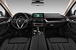 Stock photo of straight dashboard view of 2017 BMW 5-Series Sport 4 Door Sedan Dashboard