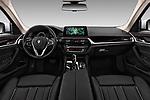 Stock photo of straight dashboard view of 2017 BMW 5-Series Sport 4 Door Sedan Dashboard