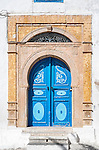 Another colourful blue door in the town of Sidi Bou Said in Tunisia. It is located about 20 km from the capital, Tunis. The town was named after a religious figure who lived there, Abou Said ibn Khalef ibn Yahia Ettamini el Beji. It is popular with tourists due to its extensive use of blue and white in its architecture. It also has a reputation as a town of artists.